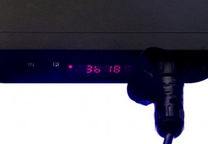 The display panel. The red circle indicates 'daylight' mode. The first digit '3' refers to the time period, in this case confirming 'daylight'. The second character, 'b' is the blue channel. '18' is the brightness level and is shown in the range 0-32